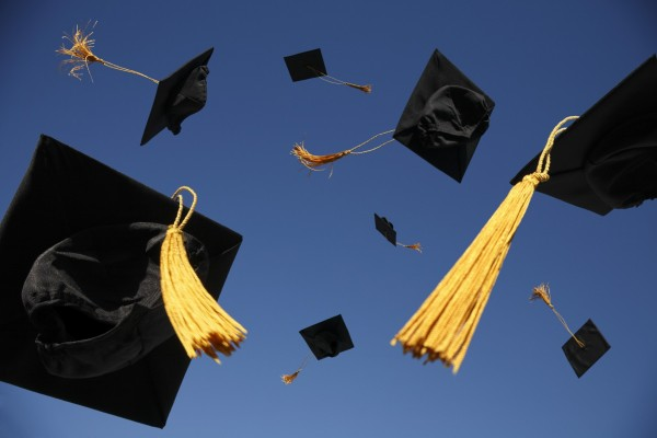 graduation-hats-in-the-air
